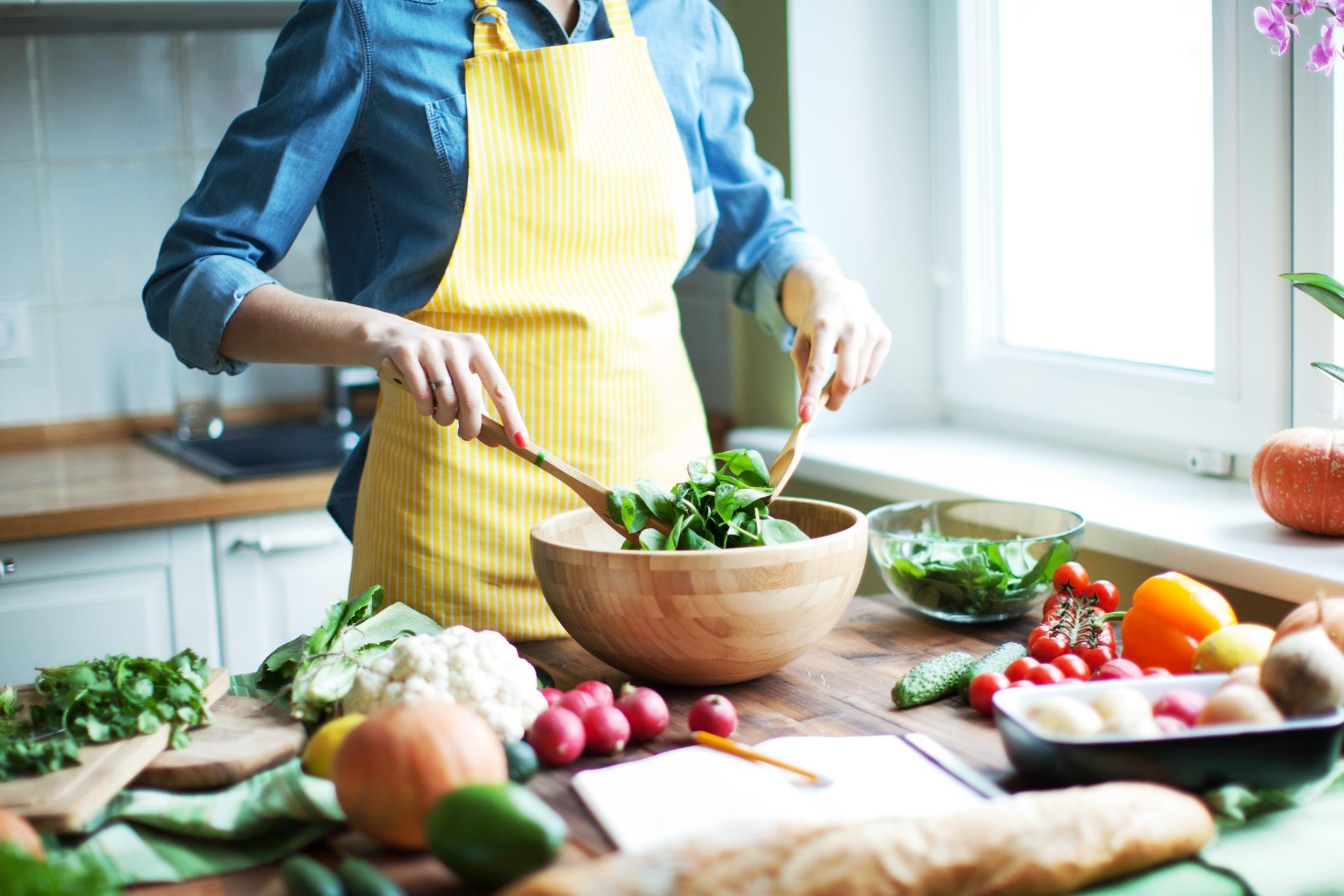 A woman preparing a healthy salad