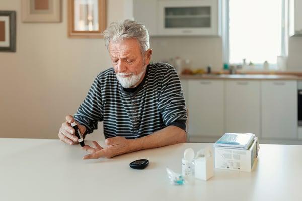 A man testing his blood sugar