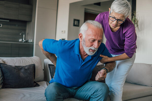 An older man with lower back pain