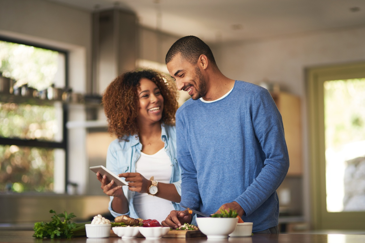 Young African-American couple cooking for weight loss