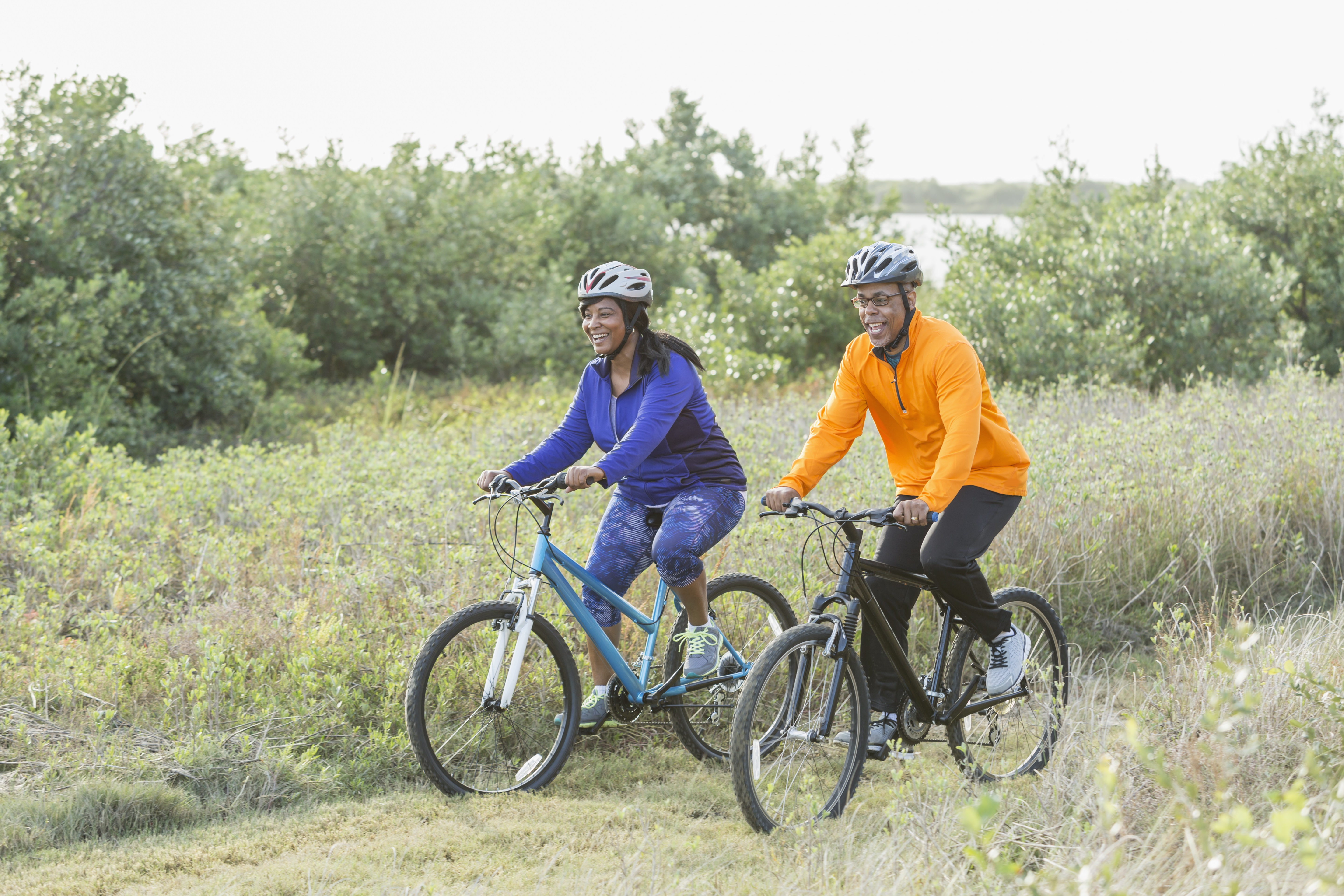 African-american couple riding bikes outside