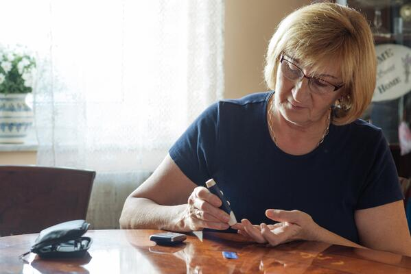 Older woman treating herself for diabetes