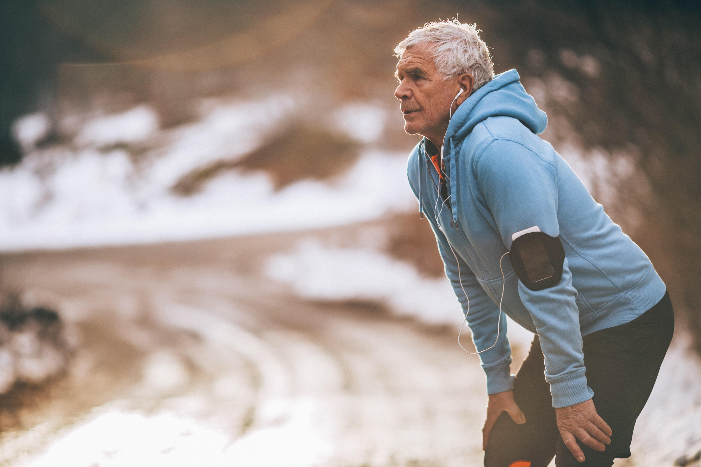 Older man running in the winter