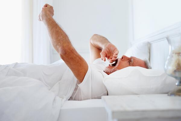 Older man having trouble falling asleep