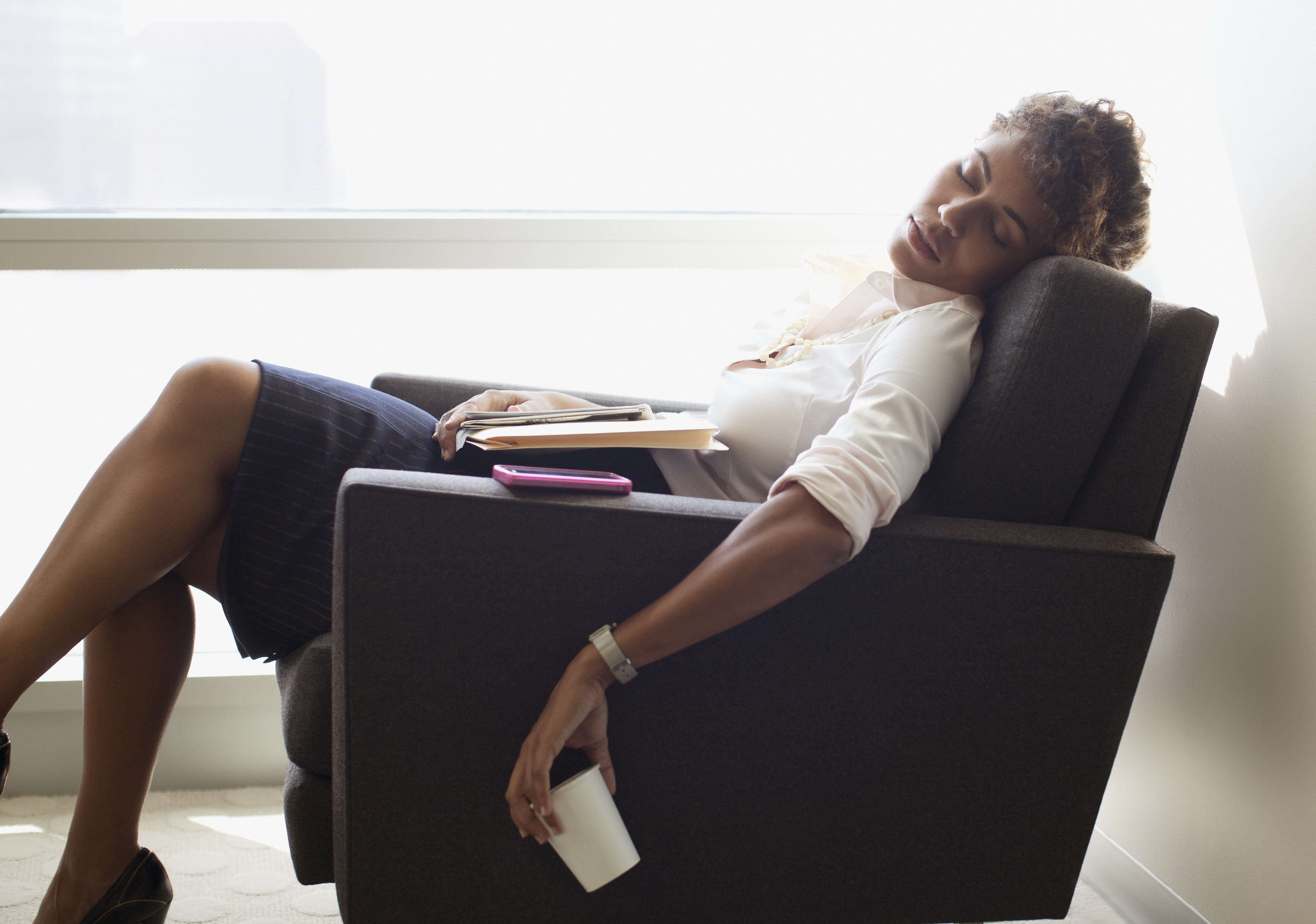 A young woman sleeping in a chair