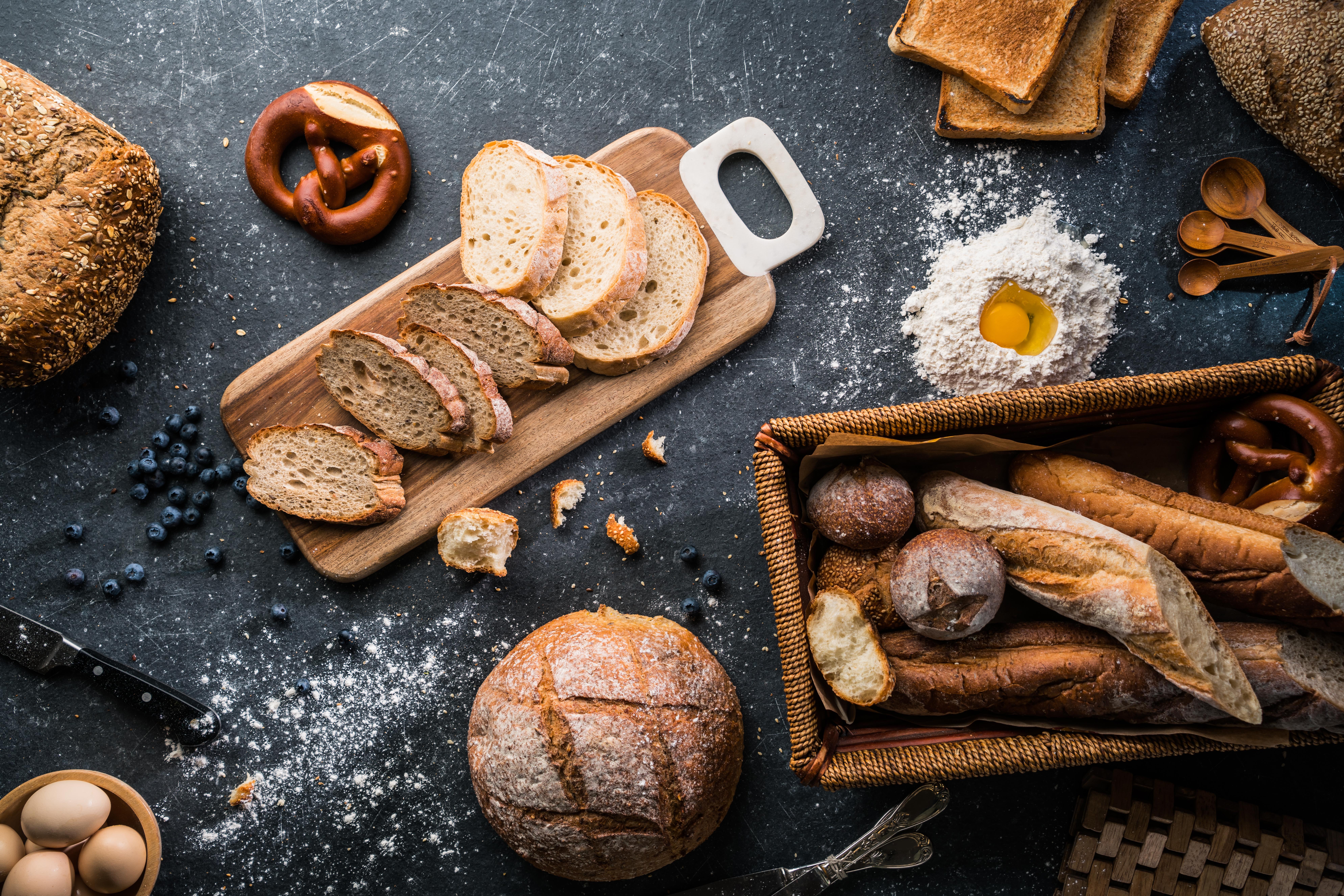 Whole bread on a wooden plank.jpg