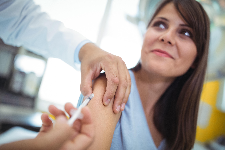 Young woman getting her flu shot