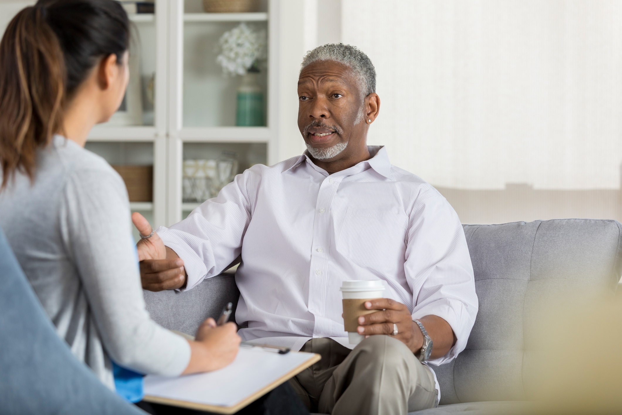 A man in his 60's talking to his doctor