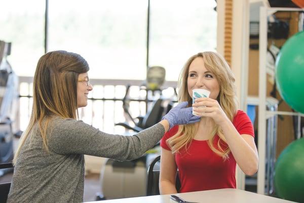 Female speech pathologist assisting adult patient