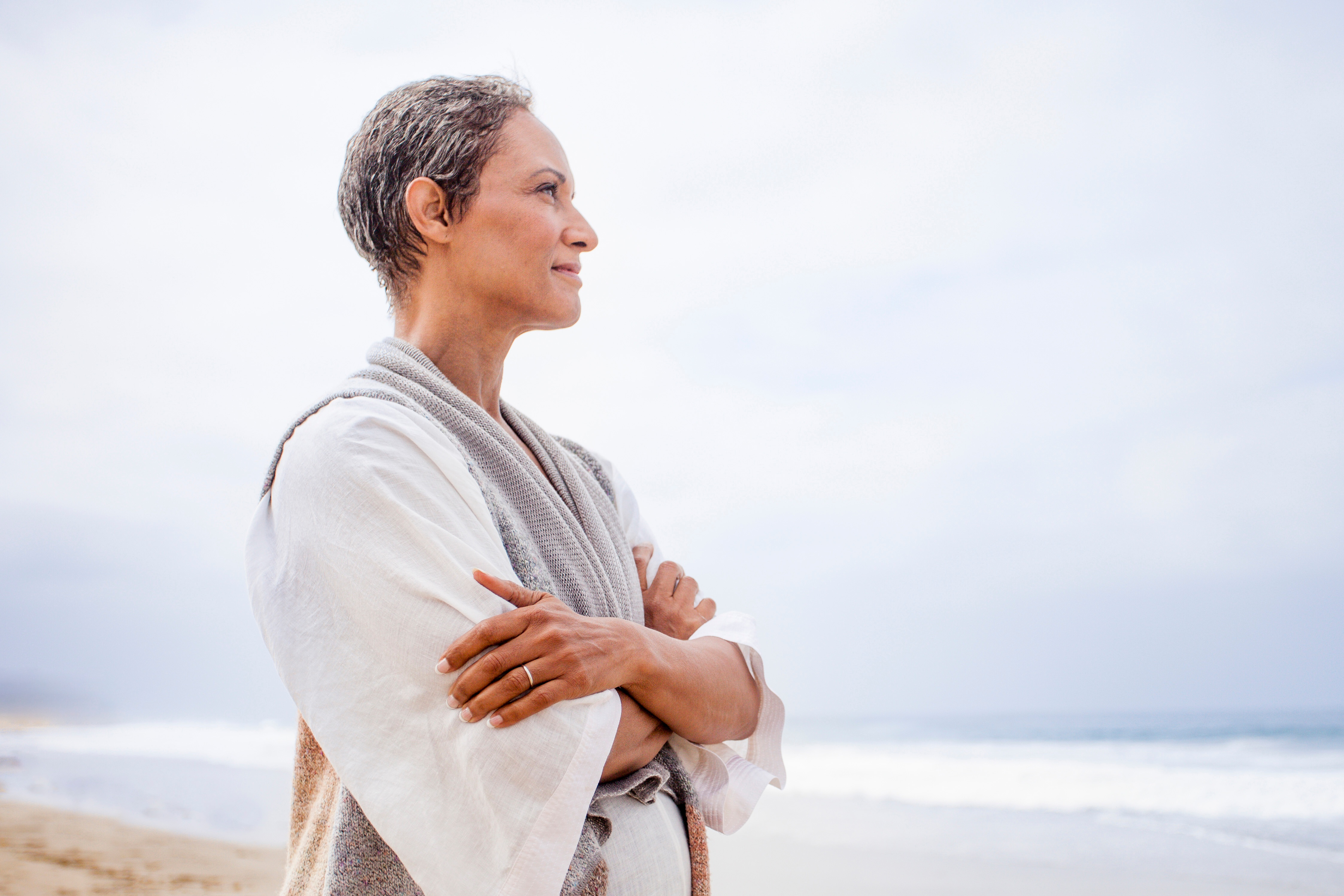 A woman in her 50's looking at the ocean